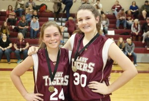 After the Riverview/Dawson game, the Lady Tigers recognized Maddie Grant (left) as their Academic Award recipient and Marlie Townley (right) as their All-Tournament selection. (Photo by: Kevin Hensley)