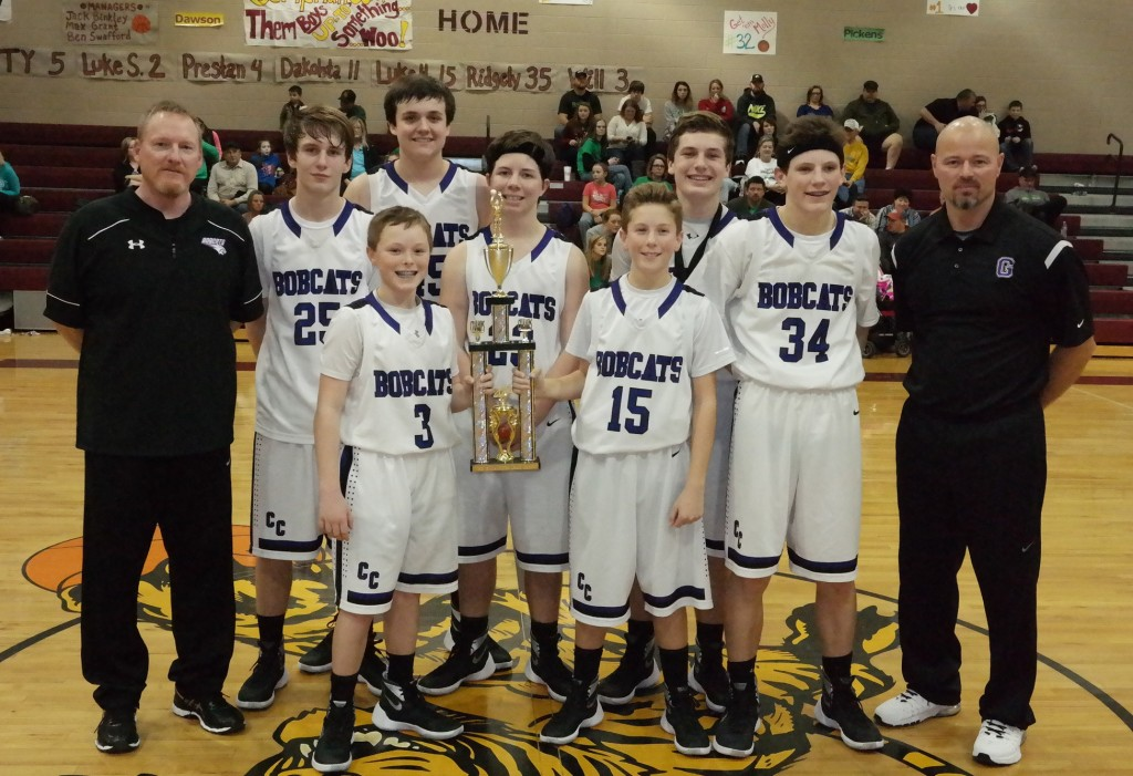 The Clear Creek Middle School Bobcats pose with the 2015-16 North Georgia Mountain League eighth-grade boys championship trophy. (Photo by: Kevin Hensley)