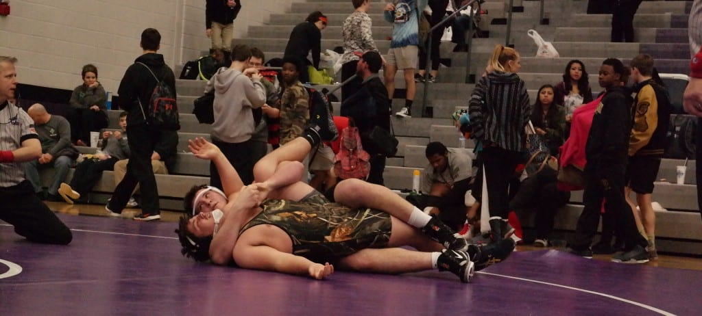 Bobcat Levi Seabolt is close to pinning his opponent at the Georgia High School Association AAAA Sectionals at Gilmer High School Feb. 6. Seabolt won the 285-pound state title last Saturday at the 2016 GHSA State Traditional Tournament in Duluth. (Photo by: Kevin Hensley)