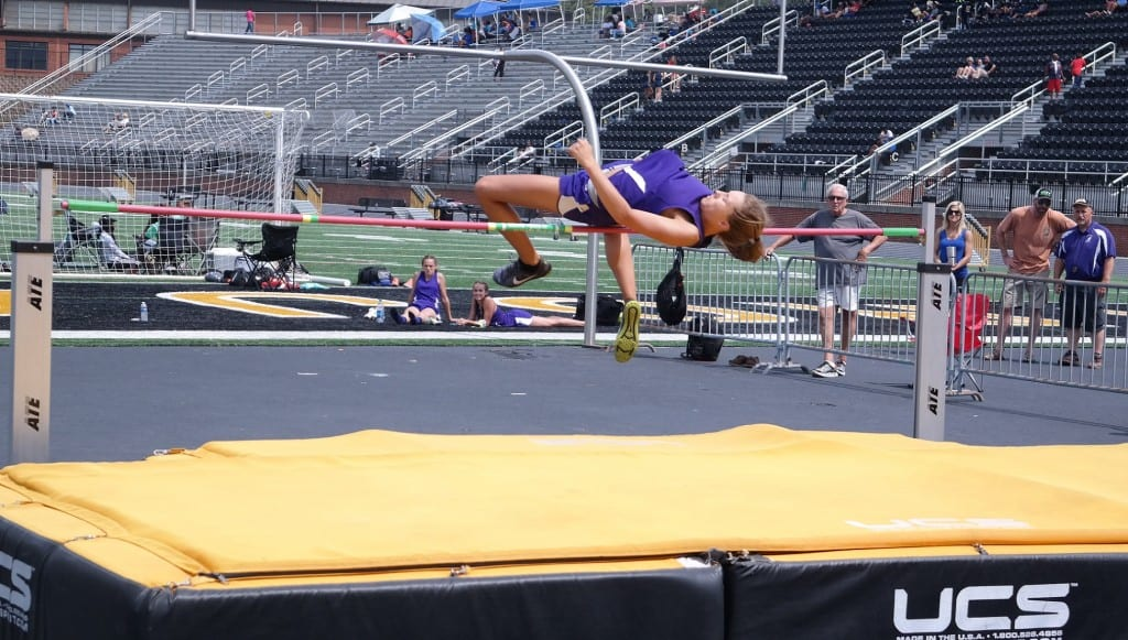 "Lady Cat senior Lauren Bentley clears 5' 2"" on the high jump, to win the girls sectionals at Carrollton High School last Saturday. (Photo by: Kevin Hensley)"