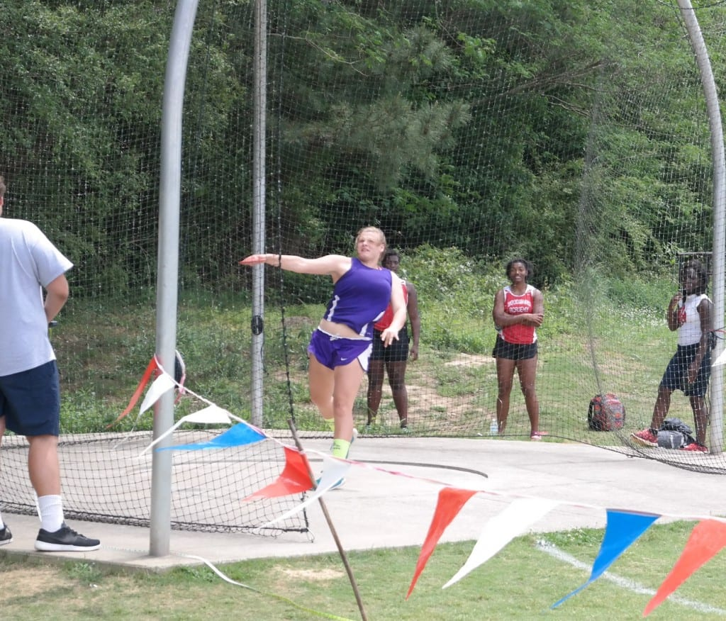 "Lady Cats junior Raven Sparks launches the discus, during the competition at the AAAA Sectionals at Carrollton High School last Saturday. Sparks broke the Gilmer Lady Cats school record in the event with a toss of 105' 11"", qualifying for state in the process. (Photo by: Kevin Hensley)"